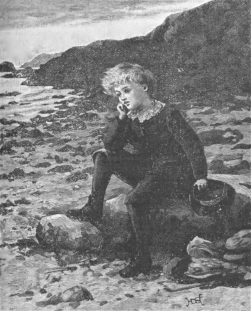 Little lad sat on the beach