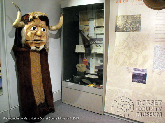 The replica Dorset Ooser mask that hangs in the Writer's Gallery of the Dorset County Museum was carved by John Byfleet in 1975 for the Wessex Morris Men and is often used in May Day celebrations at Cerne Abbas and in dance performances.  DCM © 2015